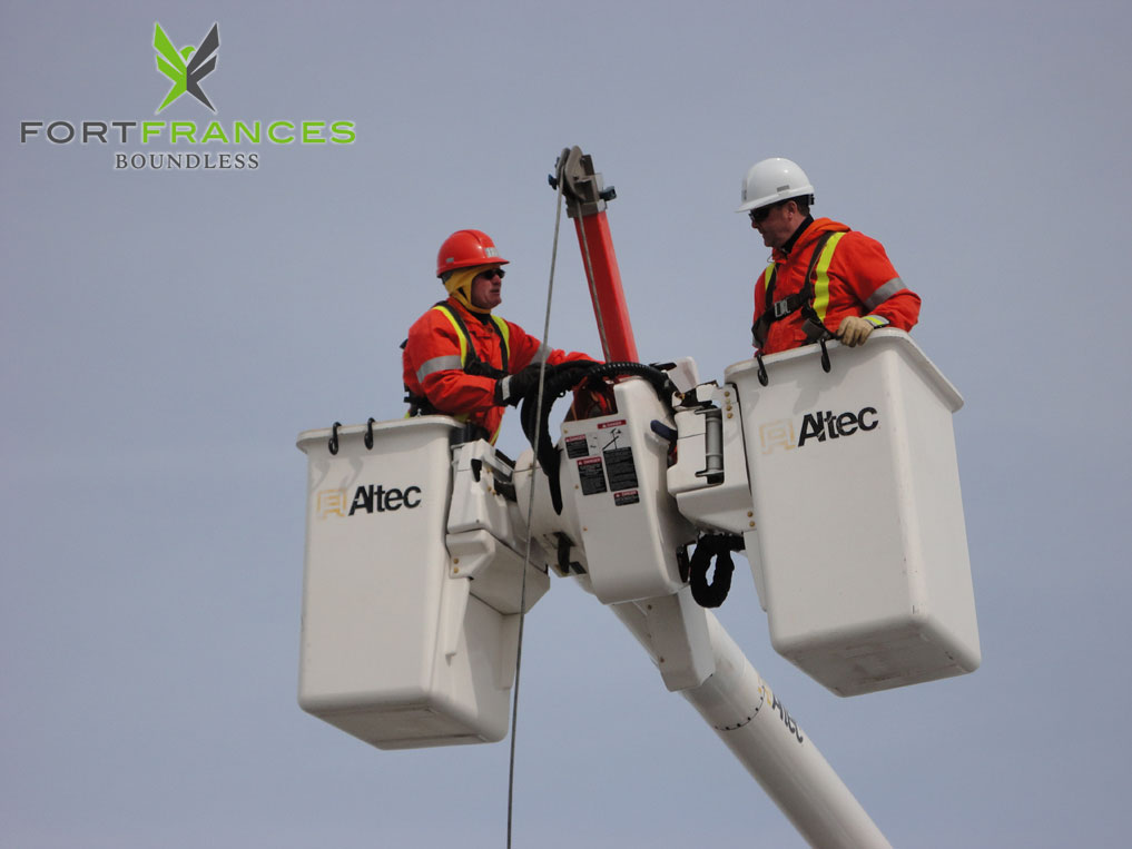 Fort Frances power corporation and hydro one workers in bucket