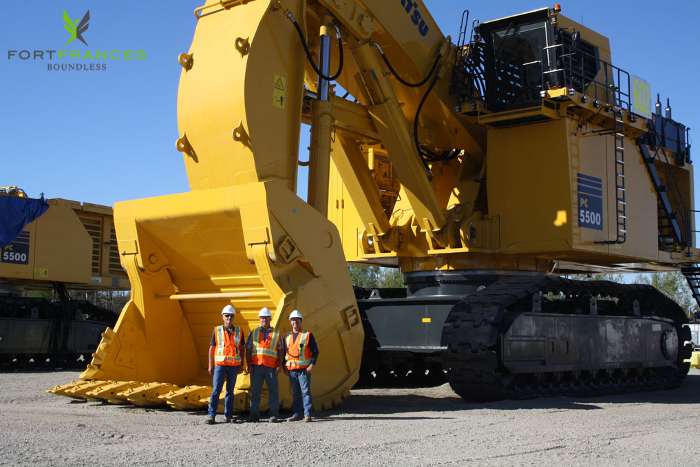 NewGold employees next to new equipment at Rainy River Project