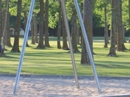 Swings, under the shade of the trees at Point Park in Fort Frances
