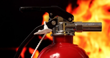 Fire extinguisher infront of flames